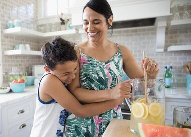 Mother in kitchen with son
